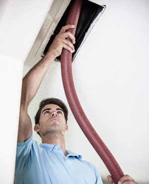 Man Cleaning Air Vent